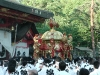 While carrying the portable pagodas around the shrine they are being shaken to honour the Shinto good Susanoo.